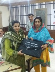 ADC Mehwish Kalbani distributing Disaster Awareness Kits to the candidates